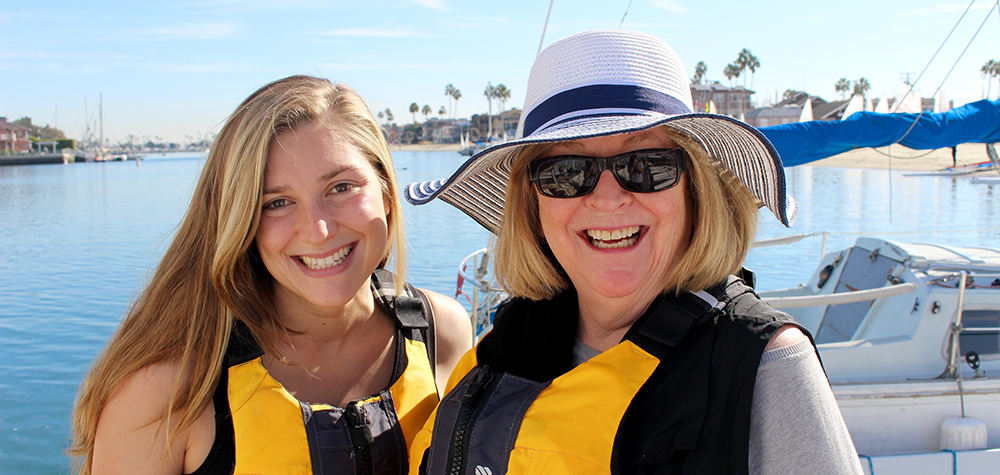 CSULB sailing club member Tatiana Misares with President Jane Close Conoley