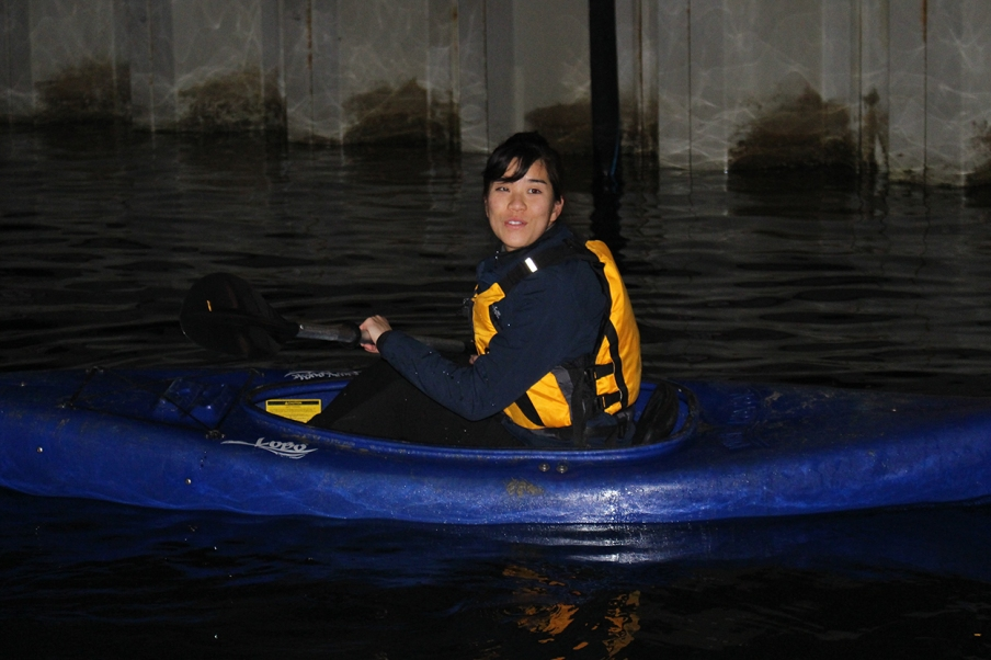 Diana kayaking through the Naples canals to check out the Christmas lights.